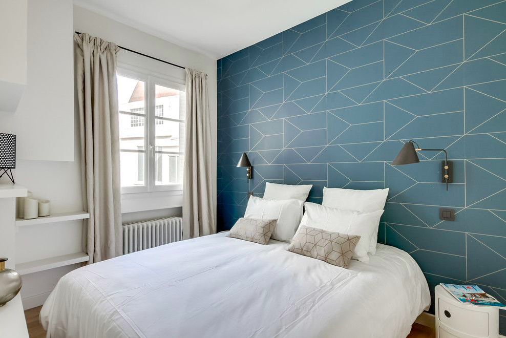 Geometric Patterned Wallpaper Behind the Bed
